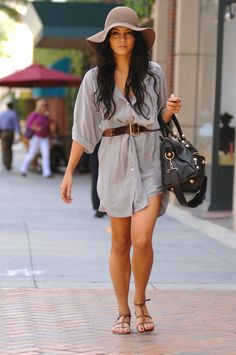 She shades her face from the sun underneath a floppy felt hat and belts her breezy shirt dress.   - MarieClaire.com