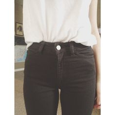 White tank with black high waisted jeans