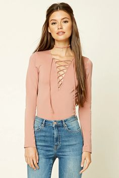 Style Deals - A knit top featuring a plunging lace-up neckline and long sleeves.