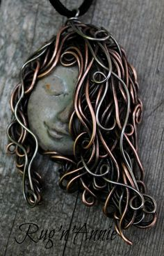 Pretty little stoneware goddess with long flowing copper and stainless steel wire hair..