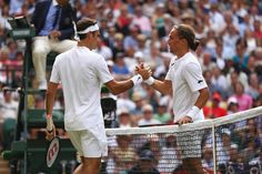Alexandr Dolgopolov Photos Photos - Roger Federer of Switzerland shakes hands with Alexandr Dolgopolov of Ukraine after their Gentlemen's Singles first round match on day two of the Wimbledon Lawn Tennis Championships at the All England Lawn Tennis and Croquet Club on July 4, 2017 in London, England. - Day Two: The Championships - Wimbledon 2017