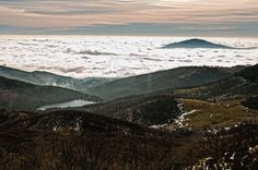Impressive sight from the top of the mountains of a sea of clouds in the sunny and cold day of winter