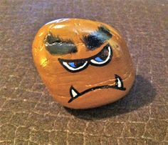 "Hand painted rock ""brown monster"". $10.00, via Etsy."
