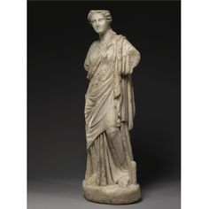 A MARBLE FIGURE OF A MUSE, ROMAN IMPERIAL, CIRCA 2ND CENTURY A.D.