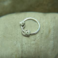 Pico Loves your Nose!!!  Unique, perfectly fit, especially for you, Sterling silver Tiny flower motif nose ring! Organic look!  handmade of Sterling Silver. ****MATERIALS  Nose ring made of 100% Sterling Silver.  Nose ring is shiny polished (by hand) finish. Smooth to the touch. ****SIZE  inner diameter: To choose when buying this nose ring.    *****AVAILABLE AS OPTION  Left or right nostril,  inner diameter nose ring 7mm, 8mm, 9mm, 10mm 11mm.    ****GAUGE  Gauge: The thickness of the wire…