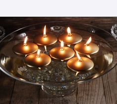 Floating gold candles in a giant martini glass floating candle bowl. Simple centerpiece for the holidays. #centerpieceideas