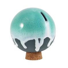 The Orb is a hand-cast porcelain money bank glazed in a myriad of hi-fire color combinations. It is available in white and grey porcelain. Each Orb rests on a c Hand Cast, It Cast, Rainy Day Fund, Money Bank, Cork Stoppers, Piggy Bank, Kids Learning, Handmade Items, Ceramics