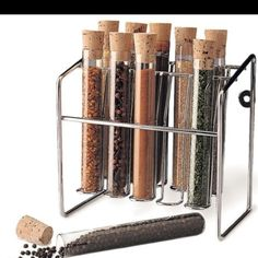 Spice Rack - Glass Spice Tube Set (Silver) x x Color: Silver Size: x x Chrome wire rack holds ten of your favorite spices. Glass tubes have a natural cork stopper for airtight freshness. Spice Rack Glass, Test Tube Spice Rack, Spice Jars, Spice Bottles, Spice Set, Spice Organization, Cork Stoppers, Organizer, Kitchen Lighting