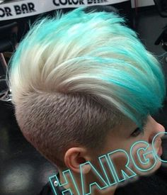 Blonde and turquoise blue dip dyed hair with shaved sides