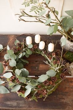 Make Advent wreath itself. DIY moss wreath for Advent with cones, eucalyptus, an . - Make Advent wreath itself. DIY moss wreath for Advent with cones, eucalyptus, branches and a lot of - Natural Christmas Tree, Red And Gold Christmas Tree, Simple Christmas, Christmas Wreaths, Christmas Crafts, Christmas Decorations, Minimal Christmas, Christmas Christmas, Moss Wreath