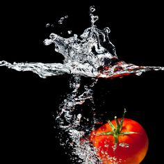 tomato falling into water high speed photography