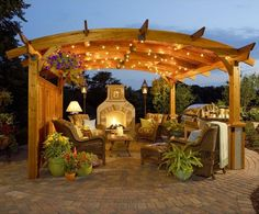 I love the pergola and fireplace