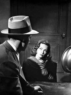 """7 awesome Film Noir movie stills - Dana Andrews puts the spotlight on Gene Tierney during the interrogation scene in """"Laura"""" - Golden Age Of Hollywood, Classic Hollywood, Old Hollywood, Hollywood Glamour, Hollywood Actresses, Gene Tierney, Classic Film Noir, Classic Movies, Old Movies"""