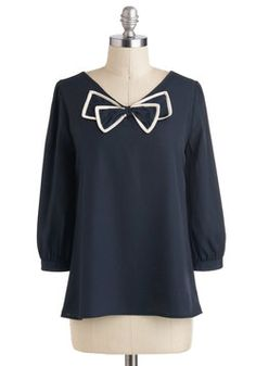 Bow Tied and True Top. Show how darling and dapper you can be by tucking this bow-adorned, navy top into a high-waisted skirt, and letting its 3/4-length sleeves and ivory trim lend charm to your day. #blue #modcloth