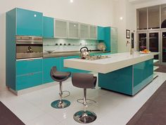 Custom built glossy blue and white kitchen design    Another great example of bold color. I'm sold on this amazing glossy blue – by Mal Corboy Design
