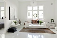 open concept open plan estilo nórdico distribución diáfana diseño interiores diáfano en pisos decoración en blanco negro toques madera cocin...