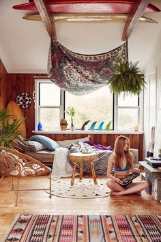 Ccolorful bohemian living space with a tapestry on the ceiling