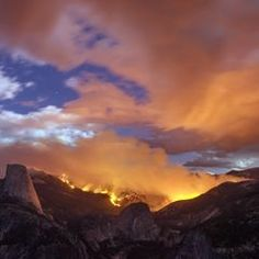 A wildfire burns near Half Dome in  Yosemite National Park, Calif., in this photo taken Sunday  As of Monday, the fire has burned four square miles.