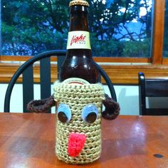Crocheted dog bottle coozy made for a charity auction.
