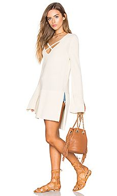 Shop for Free People Criss Cross Top in Ivory at REVOLVE. Free 2-3 day shipping and returns, 30 day price match guarantee.