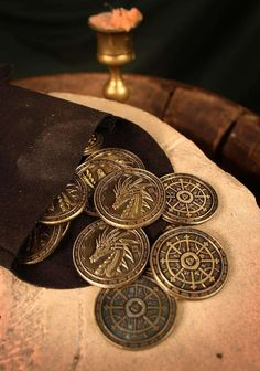 Fire Gold Coins These coins are perfect for usage as InTime-Currency and stand out because of their massive form and authentic surface. The picture. Fantasy World, Fantasy Art, Dungeons E Dragons, In Vino Veritas, Mo S, Fantasy Inspiration, Character Aesthetic, Gold Coins, Ancient Artifacts
