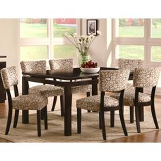 This contemporary dining set with its cappuccino finish will add a splash of style to your dining area.