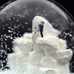 Snow globes created by Walter Martin and Paloma Munoz often times contrast pristine settings with foreboding or grisly scenes.