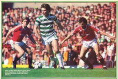 Brian McClair being watched by Gordon McQueen and Arthur Albiston during Lou Macari's testimonial at Old Trafford.