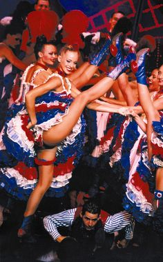 The Moulin Rouge dancers fly the French flag colours as they dance.