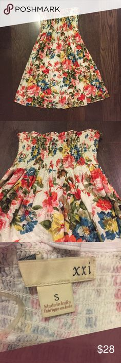 NWOT! Forever 21 Floral Strapless Dress | Size S GORGEOUS floral summer dress from Forever 21 with a lace (? Is that what it's called) overlay (view in second picture) - you will see the cut outs in the fabric. I love this dress but I frankly have no opportunity to wear it. NWOT! In perfect condition. Forever 21 Dresses Mini