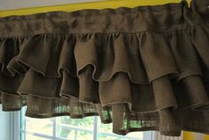 burlap  Rethinking my kitchen window curtain option.  May use the burlap and trim out with the fabric I was going to do the whole thing in.