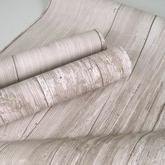 Bleached wood wallpaper. I can envision some seriously awesome IKEA hacks with this.