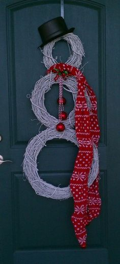Try a different style of door wreath this year and create a snowman to greet all your guests