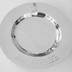 Retirement presentation silver plate with a pierced, engraved and applied crest and a hand-engraved inscription