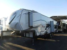 2017 New Eclipse Recreational Vehicles ATTITUDE 28 SAG, 2 SLIDES,160 WATT SOLAR,CORIAN COUNTER Fifth Wheel in California CA.Recreational Vehicle, rv, WE DO NOT CHARGE FOR PDI OR PREP FEE'S LIKE OTHER MOST DEALER'S! NEW 2017 ECLIPSE ATTITUDE 28 SAG MODEL FIFTH WHEEL TOY HAULER, 32 FT LONG, DRY WEIGHT (ONLY 8900 LBS), 2 SLIDE-OUTS, 1 LIVING AREA SLIDE-OUT AND 1 BEDROOM WARDROBE SLIDE, GREY COLORED FIBERGLASS, ALUMINUM FRAMED VACUUM-BONDED SIDE WALLS, SMOOTH SIDE, ***SIDE AISLE HALLWAY…
