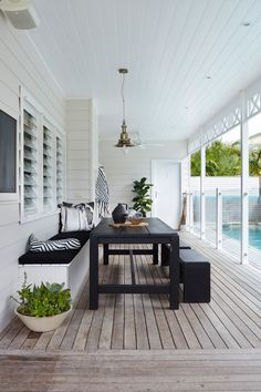 Beautiful poolside outdoor dining room on the covered porch.