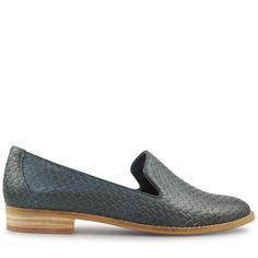 This street chic style is crafted from stunning navy scale etched leather, giving a show-stopping textured finish to the classic loafer. With its single layer inbuilt cushioning under the foot for superior comfort, and a contrasting stacked heel and rand,