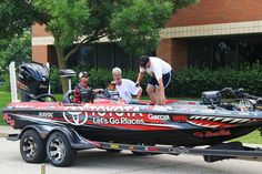 Fishidy staff admiring Mike Iaconelli's bass boat during the Take-A-Vet-Fishing cookout in Madison, Wisconsin. Bass Fishing Boats, Bass Boat, Boat Dealer, Cool Boats, Fishing Equipment, Ranger, Antique Cars, Madison Wisconsin, Sailboats