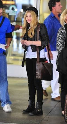 Chloe Grace Moretz wearing the most comfortable looking airport shoes. We also love her hat!