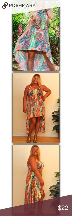 """Size 8-12!! Orange Peacock Hi-Lo Dress!! NWOT!! Enjoy a leisurely look in a laid-back dress flaunting bold boho notes. The flowing fabric daps easily along curves with a colorful peacock print and dramatic hi-low hem! Material is very stretchy and comfortable! 100% Polyester. Dress is 33"""" long from high point of shoulder to front hem; 52"""" long from highest point on shoulder to bottom hem. Size: L/XL, Fits: 8-12, Waist: 27""""-32"""", Bust: 36""""-40"""". NWOT La Moda Dresses High Low"""