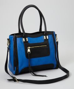 Sling this stylish staple over a shoulder for an accessory that pulls together an elegant ensemble effortlessly. Featuring a fabulously zippered design and rolled handles, plus an adjustable strap for versatile toting, this handbag will make carrying essentials a beautiful breeze.