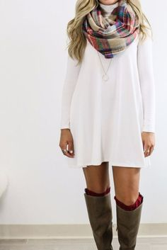 A white dress, blanket scarf and tall boots make for a perfect fall outfit!