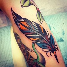 old school tattoo fearher | Great old school colorful feather tattoo for men on arm - Tattooimages ...