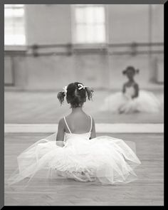 Awww I love her little pigtails and her tutu :)