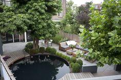 Projekty, translation missing: pl.style.ogród.nowoczesny Ogród zaprojektowane przez Biesot