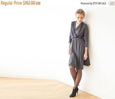 ❘❘❙❙❚❚ ON SALE ❚❚❙❙❘❘ ON SALE   Was $152 - Now $76   50% OFF The long sleeve knitted winter dress combines comfort and style. A feminine and relaxed design with a V-neckline that wraps, an elastic waistband, and a skater skirt bottom. The knit fabric is soft, stretchy, and