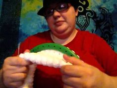Loom knitting an ear warmer • She does 25 rows of e-wrap on the green KK round loom, folds up like a brim of a hat and binds off. She does a crochet bind off but I don't know how to do that so I will try the super stretchy bind off. Very cute and very easy.