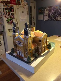 1st place gingerbread house in the Cleveland Botanical gardens contest 2014 . Saint Vitus Church , Cleveland Ohio . 49 windows and doors , 12 LED lights inside , entirely made out of gingerbread , rice Krispy and royal icing .
