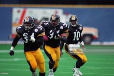 Running back Jerome Bettis #36 of the Pittsburgh Steelers runs behind the blocking of fullback Tim Lester #34 after taking a handoff from quarterback Kordell Stewart #10 during a game against the Denver Broncos at Three Rivers Stadium on December 7, 1997 in Pittsburgh, Pennsylvania.