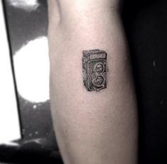 Mrs. Marina   Dr. Woo's amazing minimalistic tattoos